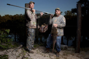 """Terral Evans and """"Gator Dundee"""" from History's """"Swamp People."""" The filmmakers behind the popular Louisiana-based series have not been playing ball with the Writers Guild of America, East, at the collective bargaining table, according to the union. (Photo by Zach Dilgard)"""